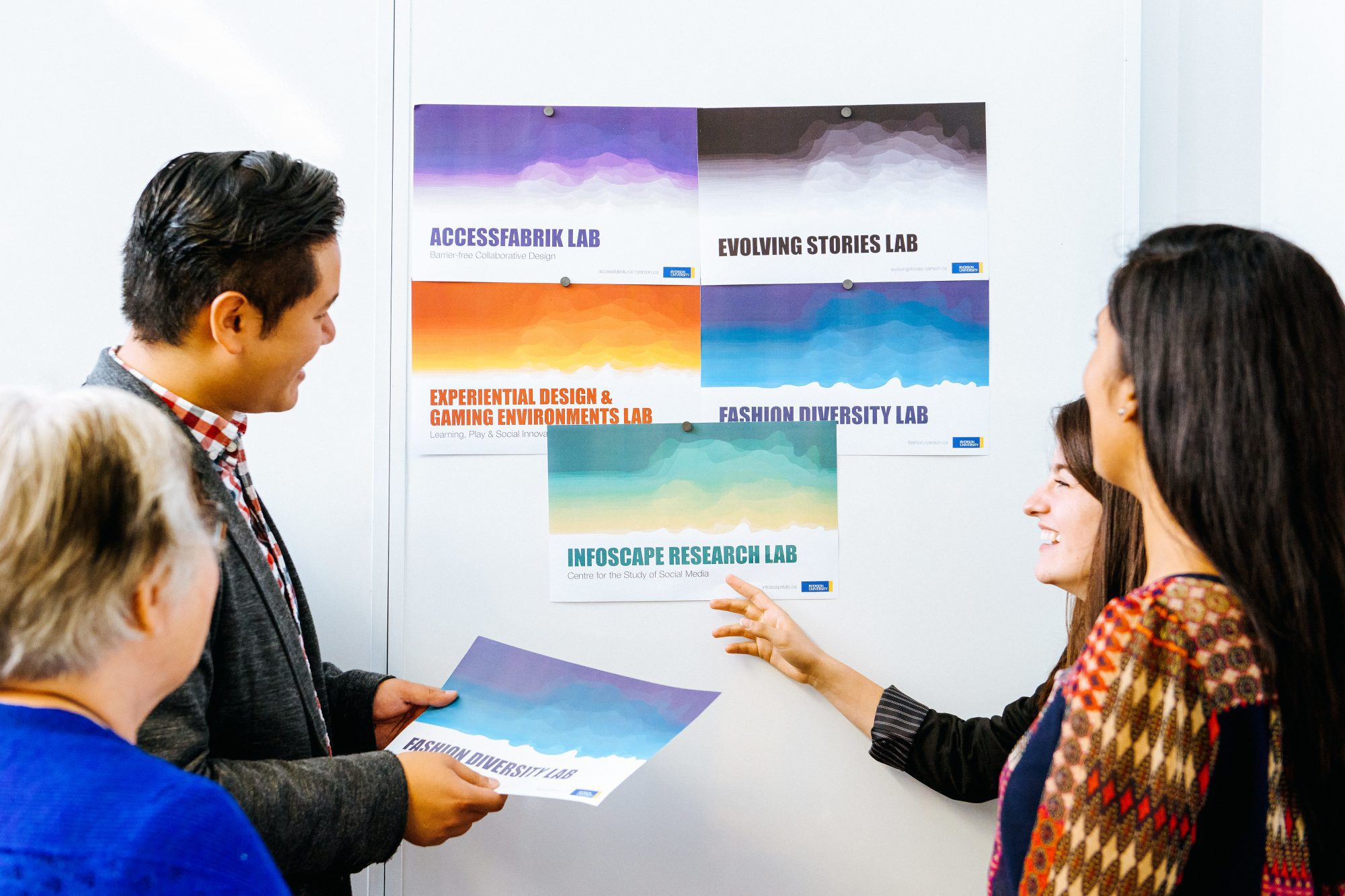 CCK employees looking at designs on a whiteboard